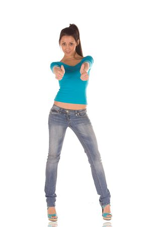 young caucasian brunette with thumbs up in casual wear. photo