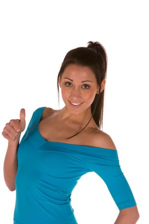 young causaian brunette in casual wear with thumbs up.Concept of positivity photo