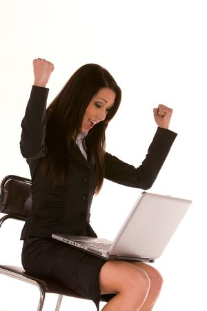 young caucasian brunette,seated with a laptop with arms up isolated on white.Concept of success. Stock Photo - 4677211