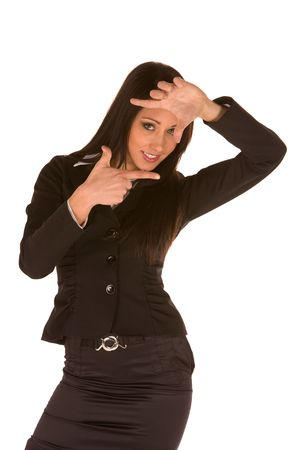 non verbal: young caucasian brunette businesswoman framing her face.Concept of relational framework,interrelactional achievement in tal and non verbal action.