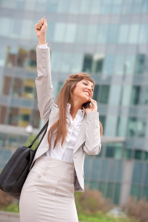 young adult caucasian businesswoman making a phone call outdoors Stock Photo - 7917396