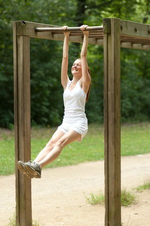 phisical: young woamn doing physical exercise outdoors