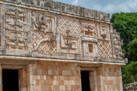 Decorations symbolizing men and snakes, of the Mayan area of Ek Balam, in the Yucatan peninsula