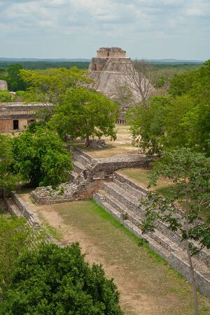 Mayan ruins of the archaeological area of Uxmal, in the Mexican peninsula of Yucatan, with the Great Pyramid in the background