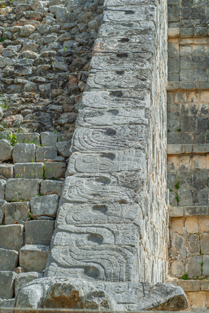 Stone staircase decorations of a Mayan pyramid in the archaeological area of Chichen Itza on the Yucatan peninsula