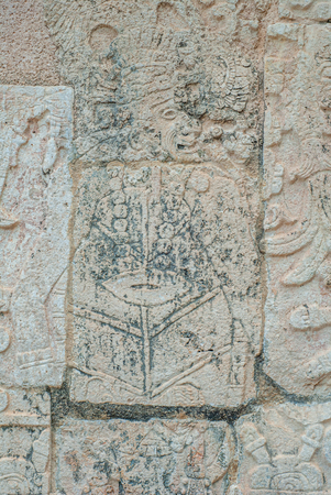 Stone engraving depicting a Mayan warrior, in the archaeological area of Chichen Itza, on the Yucatan peninsula Фото со стока