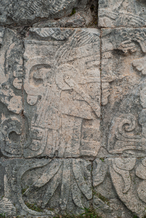 Stone carvings depicting a young Maya, in the archaeological area of Chichen Itza, on the Yucatan peninsula
