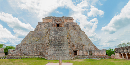Panorama of the Mayan Pyramid of the archaeological area of Uxmal, seen from the front, on the Yucatan peninsula