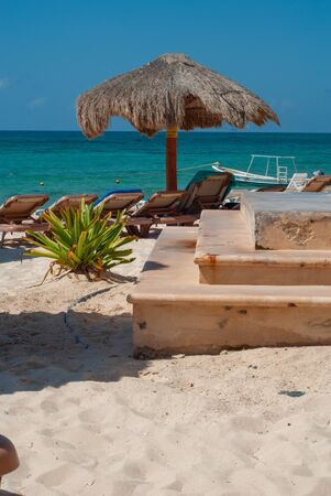 Details of a Tulum beach, with deckchairs and umbrellas, in the Mexican Yucatan peninsula