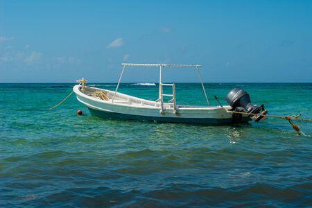 Fishing boat shot in the waters of Tulum beach, in the Mexican Yucatan peninsula