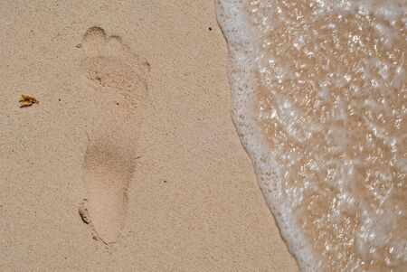Imprint of a foot in the sand of the beach, taken at Tulum in the Mexican Yucatan peninsula