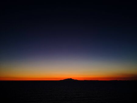 Sunset behind Ischia Island, seen from Massa Lubrense, taken in low light, to appreciate the shades of blue and orange