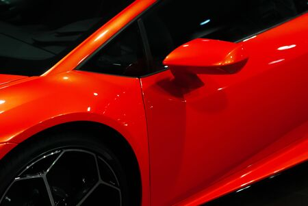 Close-up details of a orange sports car