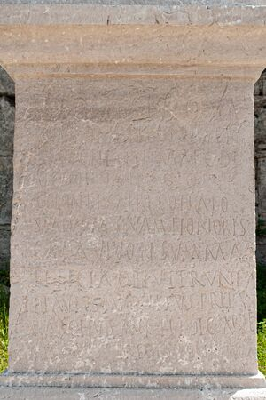 Stone column, with engravings, found in the archaeological area of Paestum Foto de archivo