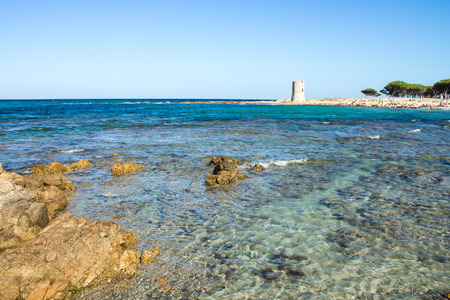 Beach with the ancient watchtower in Sardinia photo