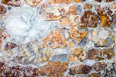 carbonates: wall of bright colored minerals embedded in rock