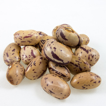 roman beans: a handful of borlotti beans isolated on white