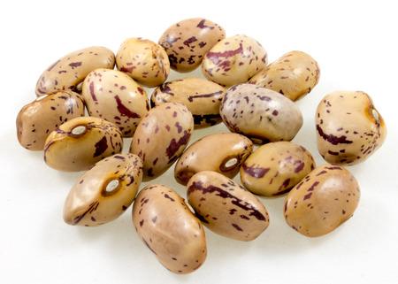 roman beans: a handful of borlotti beans isolated on white