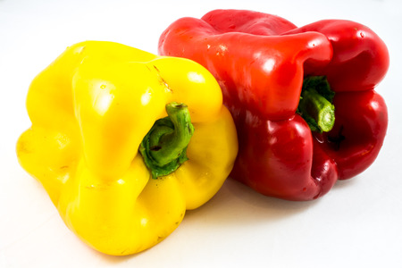 two raw bell peppers on a white background photo