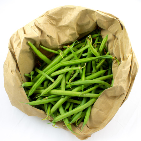 snap bean: Whole green beans in a paper bag