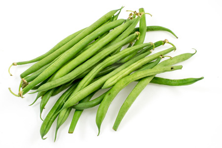 snap bean: a handful of green beans on white background