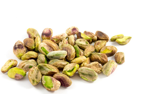 handful: Featured on a handful of shelled pistachios Stock Photo