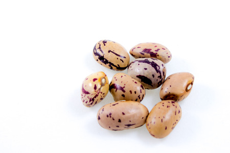roman beans: close up of some borlotti beans isolated on white Stock Photo