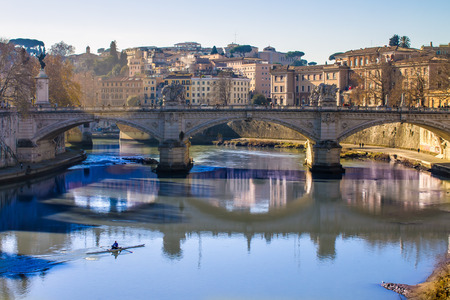 tiber: view of a bridge over the Tiber in Rome, Italy, in a sunny day