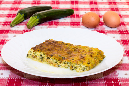 closeup of a zucchini pudding on a laid table photo
