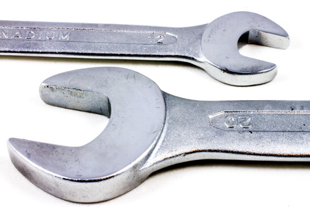 housebuilding: closeup of two wrenches isolated on white