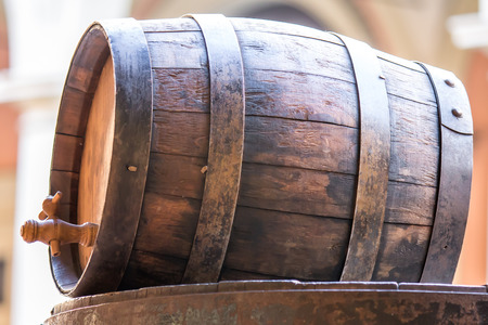 iron hoops: old wood barrel with a tap for liquids