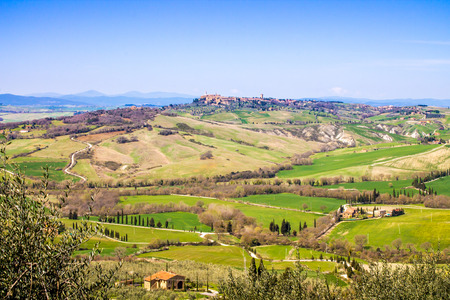 val d'orcia: tuscan landscape, view of the green Val DOrcia with Pienza town in the background
