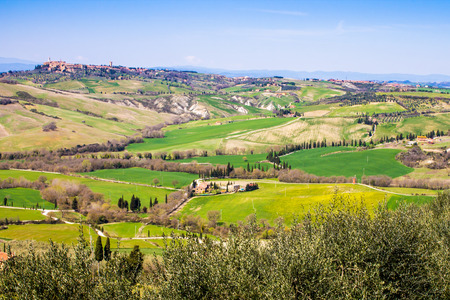 tuscan landscape, view of the green Val DOrcia with Pienza town in the background photo