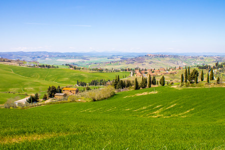 val d'orcia: tuscan landscape, view of the green Val DOrcia with Monticchiello and Pienza town in the background
