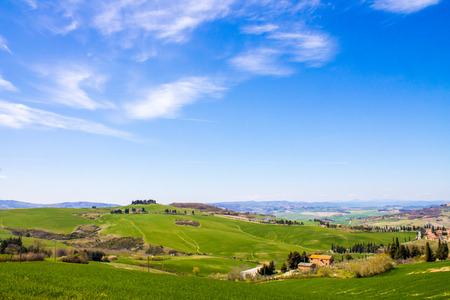 val d'orcia: tuscan landscape, view of the green Val DOrcia and a blue sky