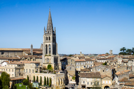 monolithic: View of the bell tower of the monolithic church in Saint Emilion, Bordeaux, France Stock Photo