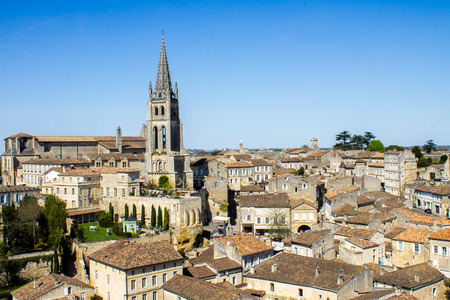 View of the bell tower of the monolithic church in Saint Emilion, Bordeaux, France 写真素材