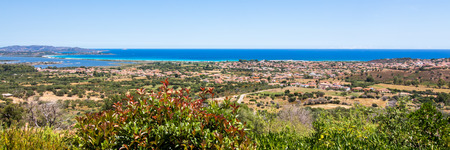 cityscape of San teodoro in the oriental coast of Sardinia, with the mediterranean sea in the background , Italy 写真素材