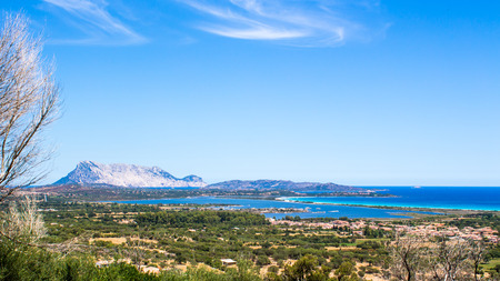 cinta: panoramic view of the coast of San Teodoro and la cinta beach with Tavolara Island in the background, Sardinia, Italy Stock Photo