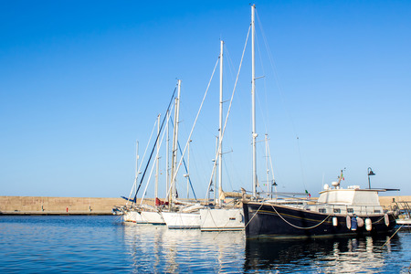 berth: row of yachts moored in a harbor