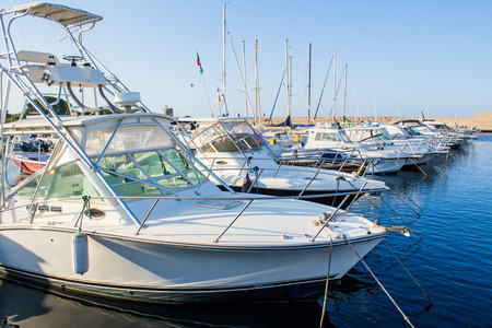 dinghies: row of yachts moored in a harbor