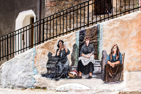 ORGOSOLO, ITALY - JUNE 26, 2015 - typical wall paintings on the streets of Orgosolo, a small town in Sardinia, Italy