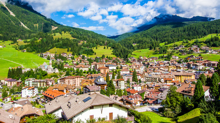 Superb summer view of the city of Moena in the Dolomites, Trentino, Italy