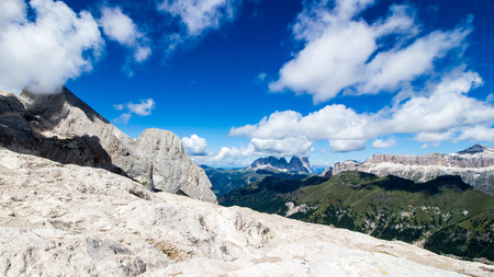 sella: panoramic view from the top of the Marmolada mountain of the groups of Sella and Langkofel, massifs in the Dolomites  in Italy Stock Photo
