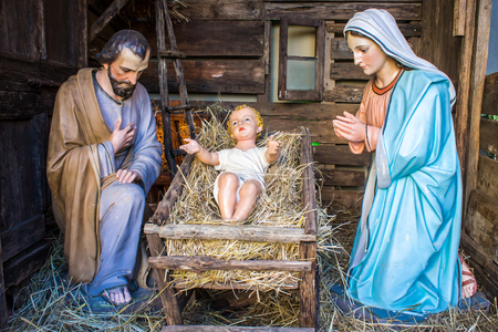 Mother Mary: Christmas nativity scene represented with statuettes of Mary, Joseph and baby Jesus Stock Photo
