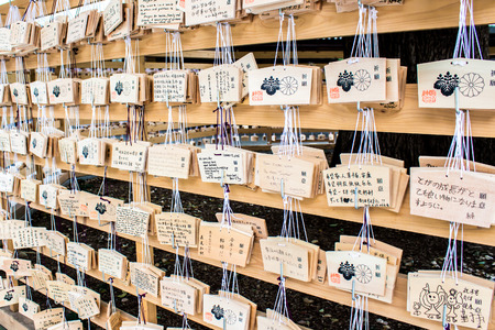 the good life: TOKYO, JAPAN - OCTOBER 10, 2015: Ema prayer tables at Meiji Jingu Shrine. Pray for happiness, good life , healthy, peace Editorial