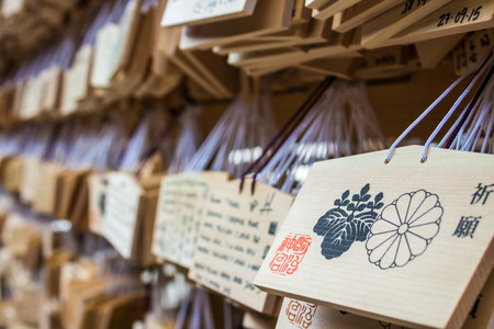 TOKYO, JAPAN - OCTOBER 10, 2015: Ema prayer tables at Meiji Jingu Shrine. Pray for happiness, good life , healthy, peace Publikacyjne