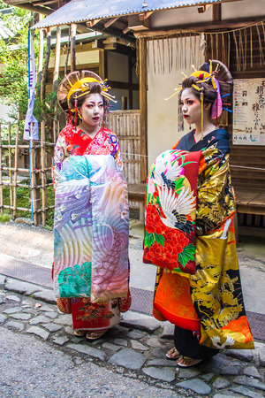 maiko: KYOTO, JAPAN - OCTOBER 12, 2015 : portrait of two Maiko, Apprentices geisha, in Kyoto, Japan.