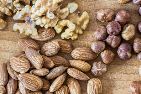 shelled: assorted nuts shelled on wooden background
