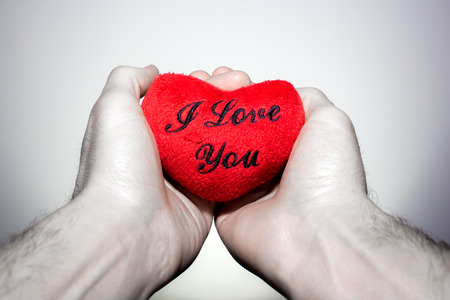 truelove: Two hands holding a  red heart that says I Love You